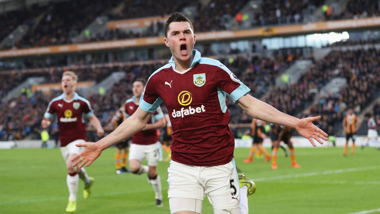 Michael Keane of Burnley celebrates scoring his sides first goal during the Premier League match between Hull City and Burnley