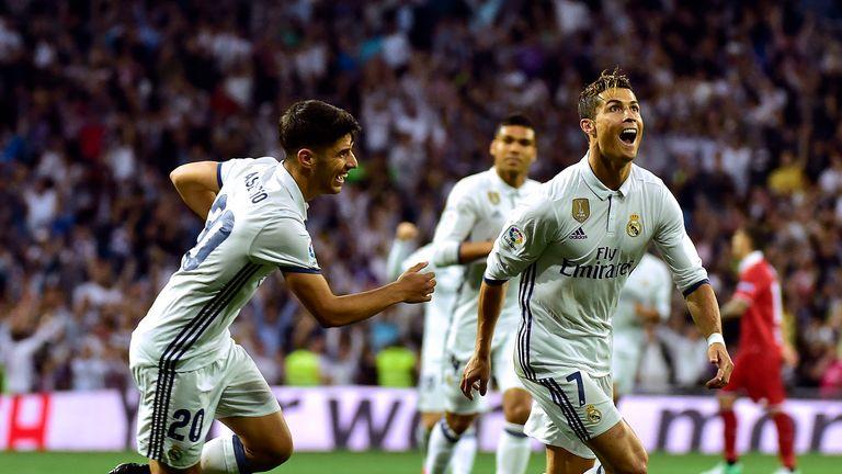 Cristiano Ronaldo celebrates after scoring during the la Liga match against Sevilla FC