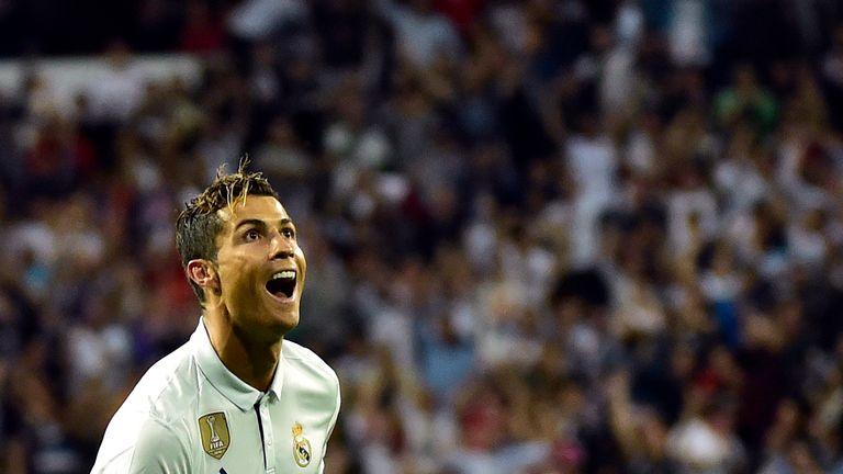 Real Madrid's Portuguese forward Cristiano Ronaldo celebrates after scoring during the Spanish league football match Real Madrid CF vs Sevilla FC at the Sa