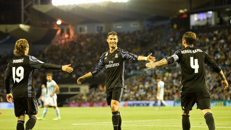 VIGO, SPAIN - MAY 17: Luka Modric, Cristiano Ronaldo and Sergio Ramos of Real Madrid celebrates the third goal against RC Celta during the La Liga match, b