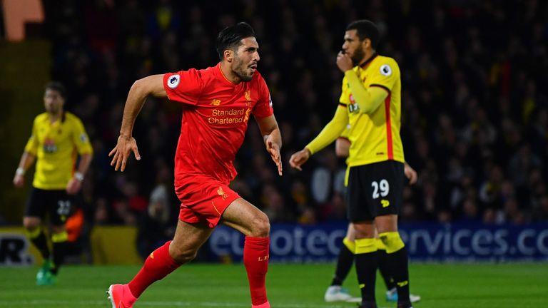 Emre Can celebrates scoring a stunning overhead kick against Watford