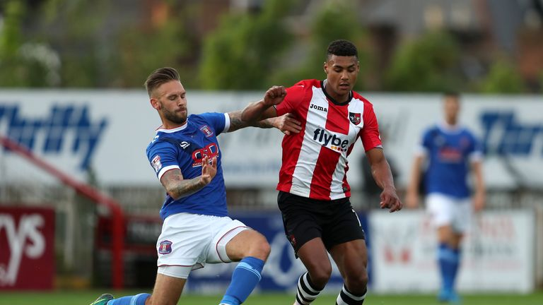 Exeter City's Ollie Watkins (right) and Carlisle United's James Bailey battle for the ball during the Sky Bet League Two play-off second leg at St James Pa