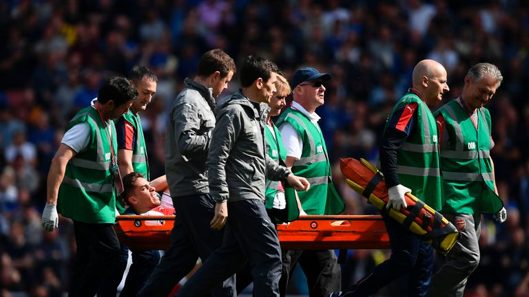 Gabriel is stretchered off injured during the English Premier League football match between Arsenal and Everton at the Emirates Stadium