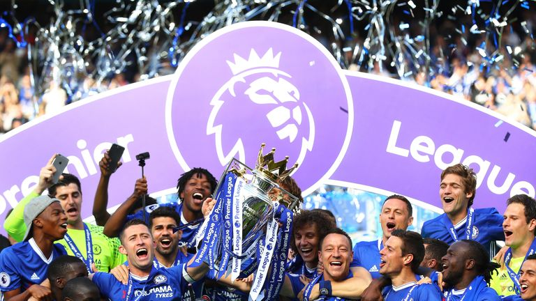 Gary Cahill and John Terry lift the Premier League trophy at Stamford Bridge