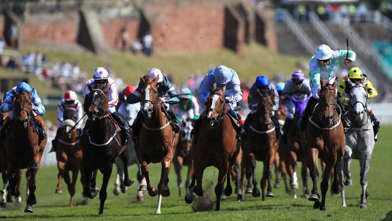 Montaly ridden by jockey Oisin Murphy (centre right) on the way to winning the 188Bet Chester Cup