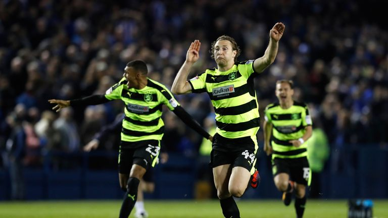 Hefele leads the Huddersfield celebrations after they won on penalties