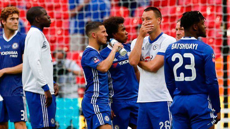 Chelsea players stand dejected after the final whistle
