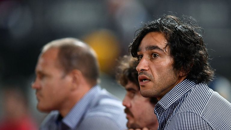 Johnathan Thurston of the Cowboys looks on from the bench