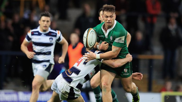 Alex Lewington of London Irish loses the ball in the tackle from Yorkshire Carnegie's Jonah Holmes