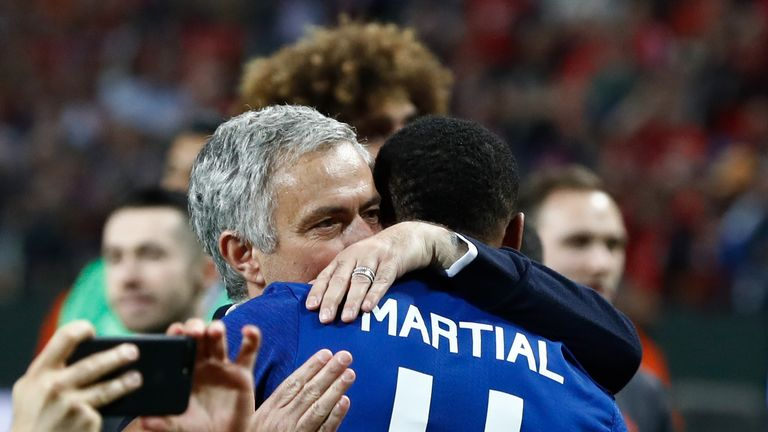 Jose Mourinho and Martial embrace after United's Europa League win in Stockholm