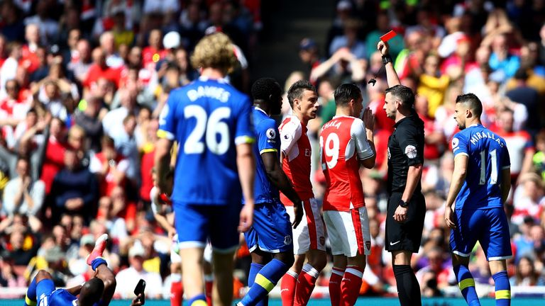 LONDON, ENGLAND - MAY 21: Laurent Koscielny of Arsenal is shown a red card by referee Michael Oliver during the Premier League match between Arsenal and Ev