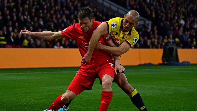 Liverpool's James Milner of Liverpool is tackled by Nordin Amrabat