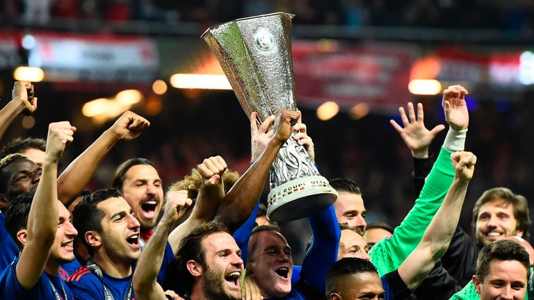 TOPSHOT - Manchester United's players celebrate with the trophy after winning the UEFA Europa League final football match Ajax Amsterdam v Manchester Unite