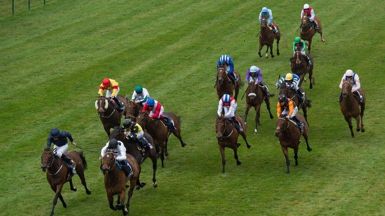 Marsha ridden by Luke Morris wins the Longholes Palace House Stakes ahead of Washington DC