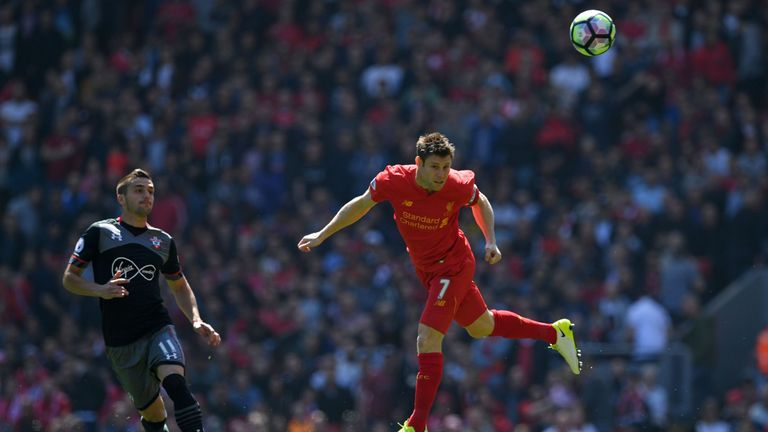 Liverpool's English midfielder James Milner heads the ball during the English Premier League football match between Liverpool and Southampton at Anfield.