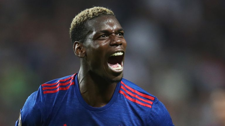 STOCKHOLM, SWEDEN - MAY 24:  Paul Pogba of Manchester United celebrates victory following the UEFA Europa League Final between Ajax and Manchester United a
