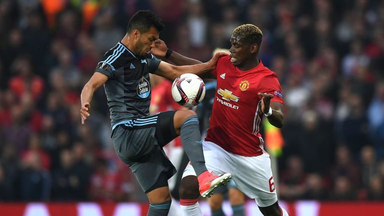 Gustavo Cabral battles with Paul Pogba during the first half at Old Trafford
