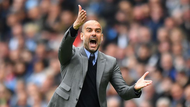 Pep Guardiola shouts from the touchline during the match at the Etihad Stadium