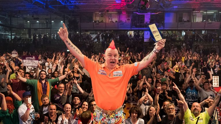 Peter Wright celebrates his European Darts Grand Prix with the fans in Sindelfingen
