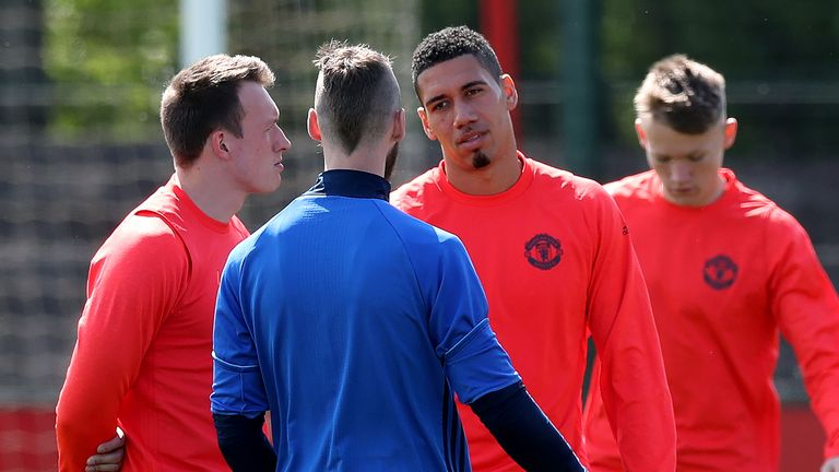 Phil Jones (left), David de Gea and Chris Smalling during a training session at the AON Complex