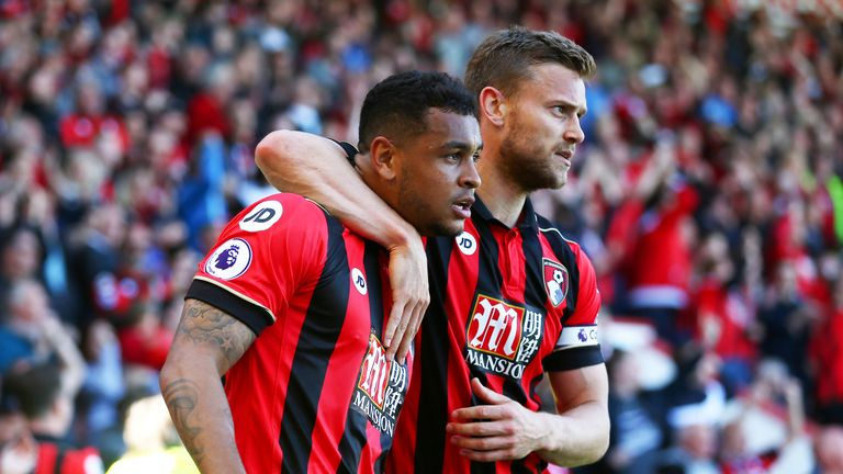 Josh King is congratulated by Bournemouth team-mate Simon Francis after scoring the winner at the Vitality Stadium