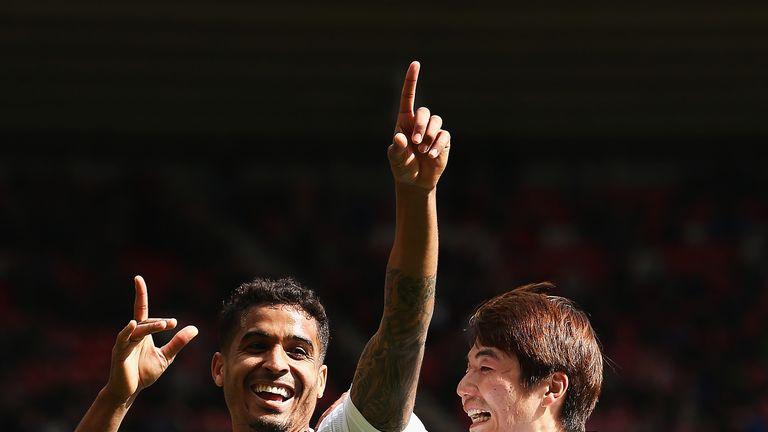 Kyle Naughton celebrates scoring for Swansea with Ki Sung-Yueng