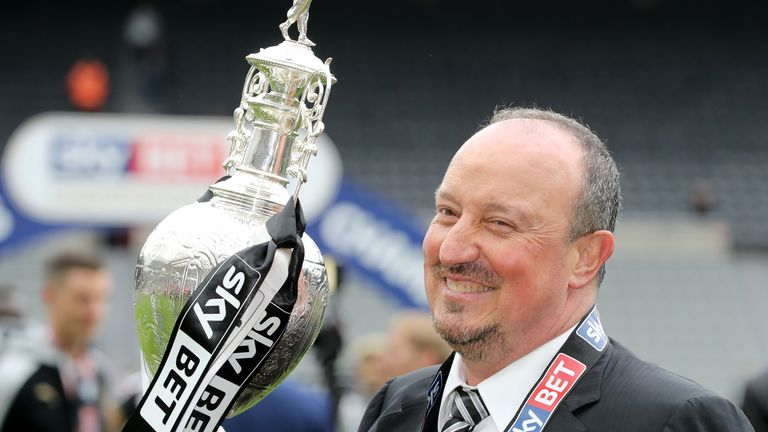 Rafa Benitez celebrates with the Sky Bet Championship trophy after the final game of the season