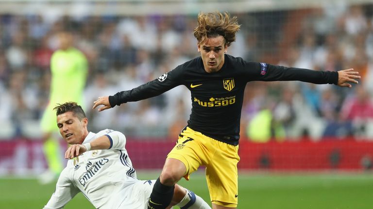 MADRID, SPAIN - MAY 02:  Antoine Griezmann of Atletico Madrid and Cristiano Ronaldo of Real Madrid battle for the ball during the UEFA Champions League sem