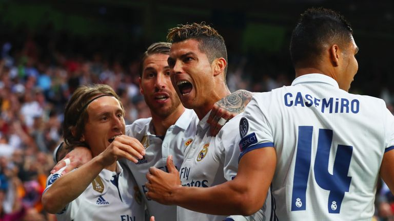MADRID, SPAIN - MAY 02:  Cristiano Ronaldo of Real Madrid (2R) celebrates as he scores their first goal with team mates during the UEFA Champions League se
