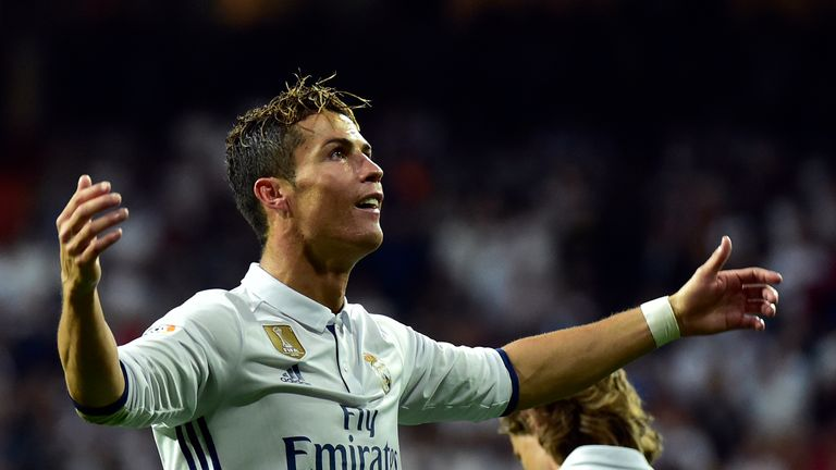 Real Madrid's Portuguese forward Cristiano Ronaldo celebrates after scoring a goal during the Spanish league football match Real Madrid CF vs Sevilla FC at