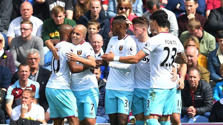 West Ham United's Sofiane Feghouli (second left) is congratulated on scoring his team's equaliser