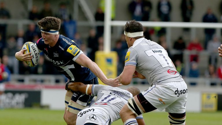 Tom Curry (left) of Sale Sharks tackled by Bath's Aled Brew