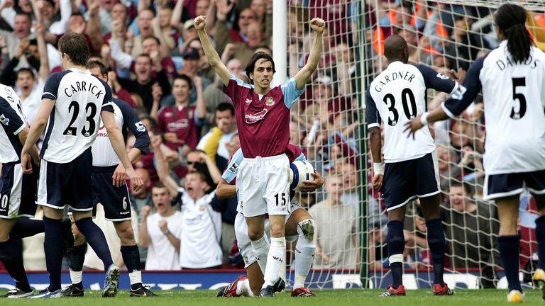 Yossi Benayoun celebrates scoring the winning goal against Tottenham