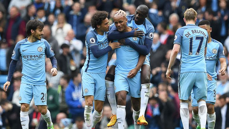 Vincent Kompany celebrates with team-mates after doubling Manchester City's lead