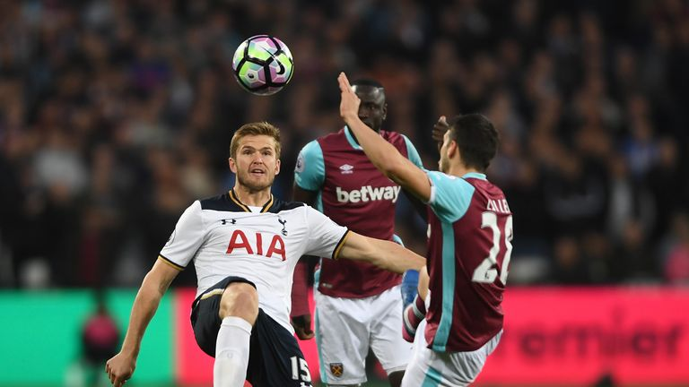 Eric Dier and Jonathan Calleri compete for the ball