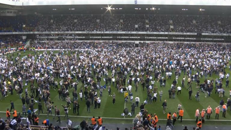 Supporters invaded the pitch at the final whistle in celebration