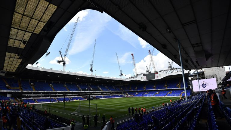 Cranes are seen above White Hart Lane in London, on May 14, 2017 ahead of the English Premier League football match between Tottenham Hotspur and Mancheste