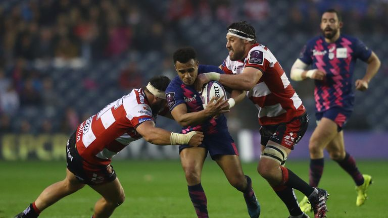 Will Genia of Stade Francais is tackled by Josh Hohneck and Jeremy Thrush (right) of Gloucester