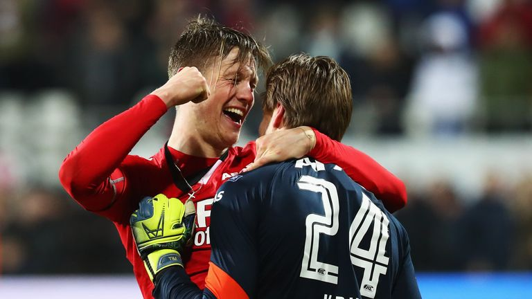 ALKMAAR, NETHERLANDS - MARCH 02:  Tim Krul of AZ Alkmaar celebratres with Wout Weghorst after saving the final penalty in the shoot out to win the Dutch KN