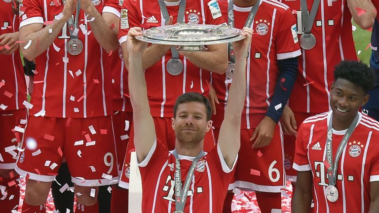 Spanish midfielder Xabi Alonso celebrates with the Bundesliga trophy after FC Bayern Munich vs SC Freiburg, his last match for the club