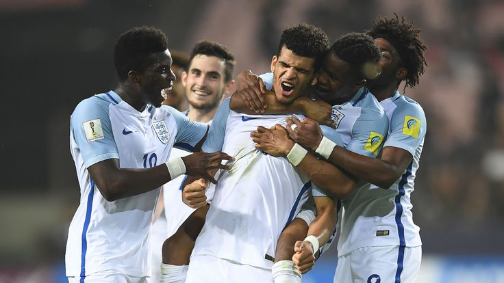 Dominic Solanke (C) celebrates his goal with team-mates during the U20 World Cup semi-final against Italy