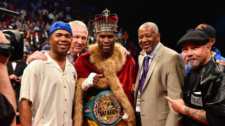 MONTREAL, QC - JUNE 03:  Adonis Stevenson poses for photos with his trainer SugarHill Steward (left) and Sam Watson (right) during the WBC light heavyweigh