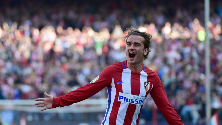 Atletico Madrid's French forward Antoine Griezmann celebrates after scoring during the Spanish league football match Club Atletico de Madrid vs Sevilla FC