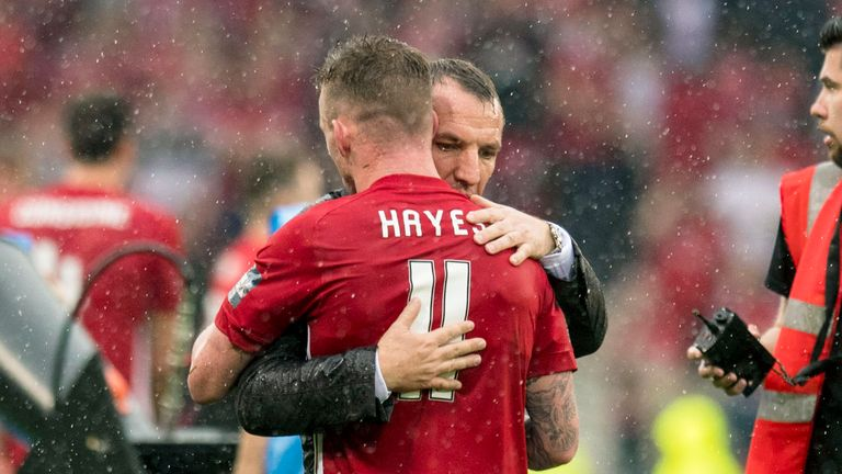 Jonny Hayes receives a consolatory hug from Brendan Rodgers after the Cup final