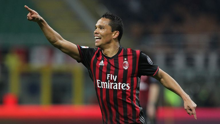 Carlos Bacca of AC Milan celebrates after scoring the opening goal during the Serie A match between AC Milan and AC Chievo Verona