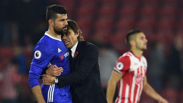 Chelsea's Italian head coach Antonio Conte (2nd L) embraces Chelsea's Brazilian-born Spanish striker Diego Costa (L) after the English P