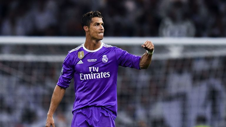 Cristiano Ronaldo of Real Madrid celebrates after scoring his team's third goal during the UEFA Champions League Final