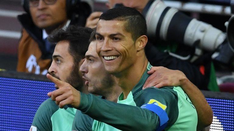 Portugal's forward Cristiano Ronaldo (R) celebrates after scoring a goal during the 2017 Confederations Cup group A football match between Russia and Portu