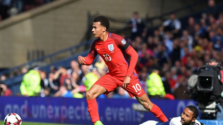 England's midfielder Dele Alli (L) vies with Scotland's midfielder Ikechi Anya during the group F World Cup qualifying football match between Scotland and