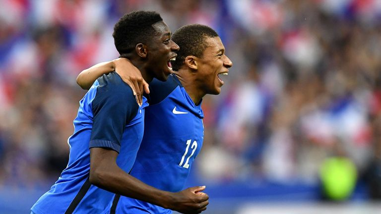 Mbappe congratulates Ousmane Dembele following his goal for France against England in Paris